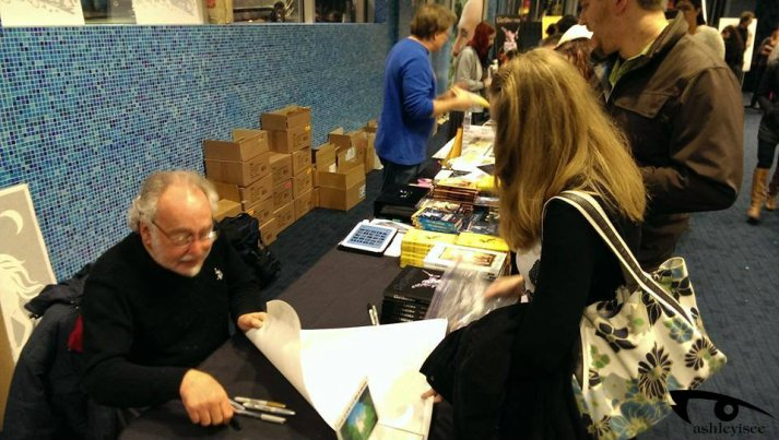 Peter signing Litograph